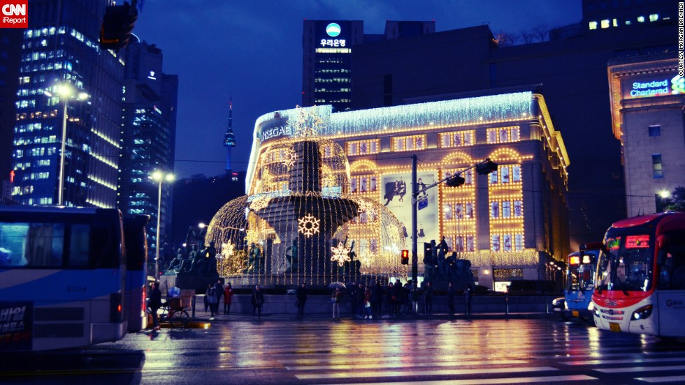 "Seoul's Shinsegae Department Store, covered in lights, was this year's first encounter with real Christmas decorations for American Korean language student <a href=""http://ireport.cnn.com/docs/DOC-1065524"" target=""_blank"">Morgan Brenner</a>. ""I sent the photo to friends and family in the US, and my father commented that Seoul seemed far more Christmassy than my hometown in Ohio at the time."""