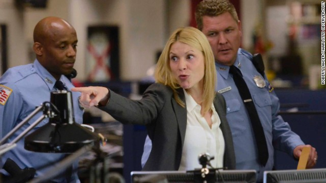 """Claire Danes acts in a scene as Showtime brings the production of """"Homeland"""" to the newsroom floor of the Charlotte Observer, May 28, 2013 in Charlotte, North Carolina."""