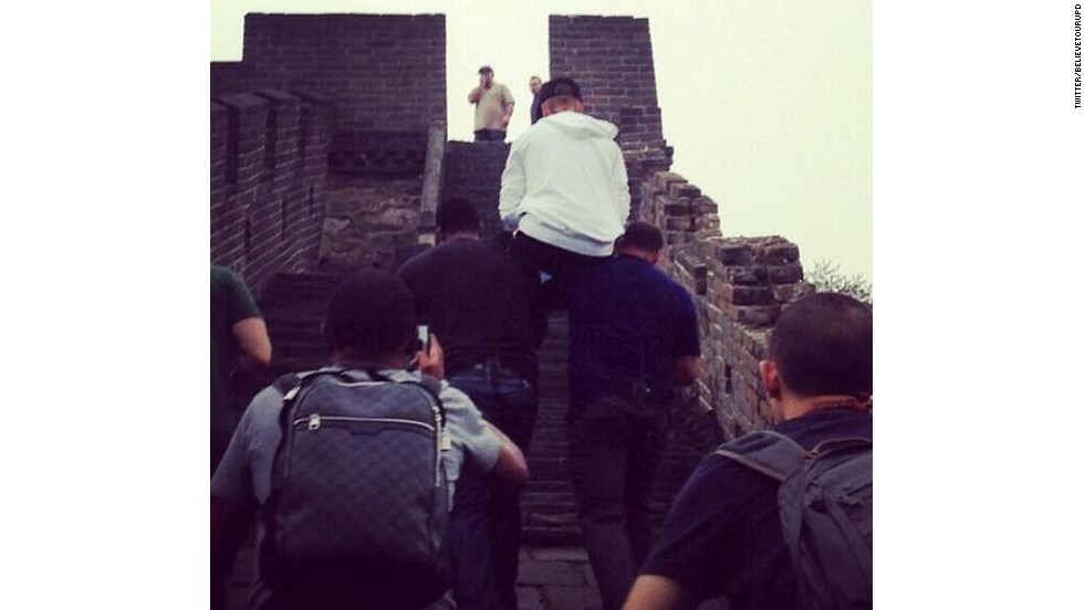 A widely distributed photo of the seemingly able-bodied Canadian pop star hoisted on the shoulders of his lackeys at the iconic site invoked mockery worldwide.