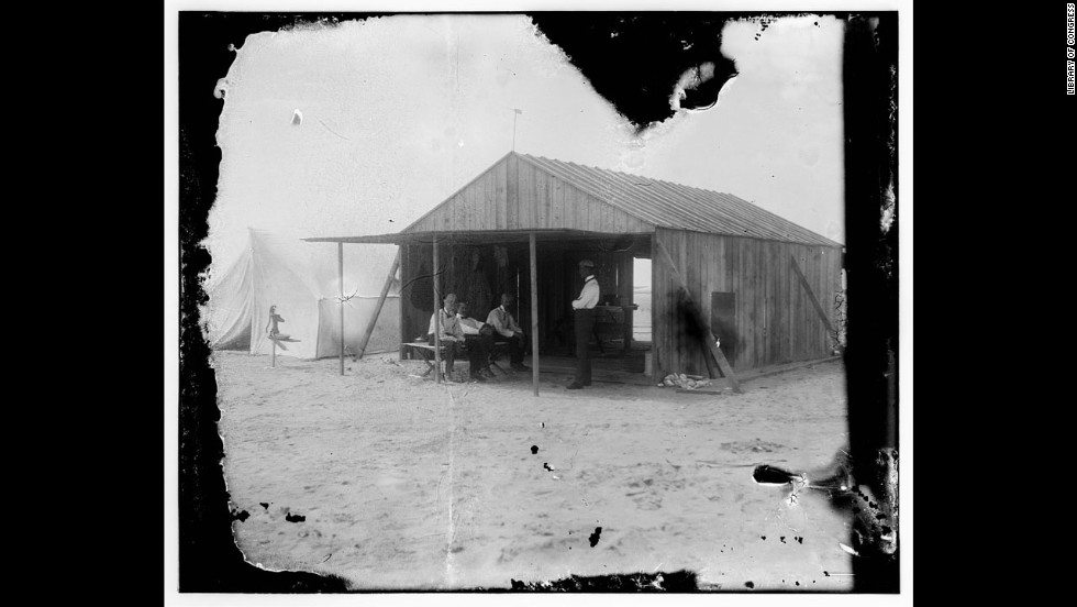 The brothers work at a shed in Kitty Hawk. From left are Octave Chanute, Orville Wright, Edward C. Huffaker and Wilbur Wright.