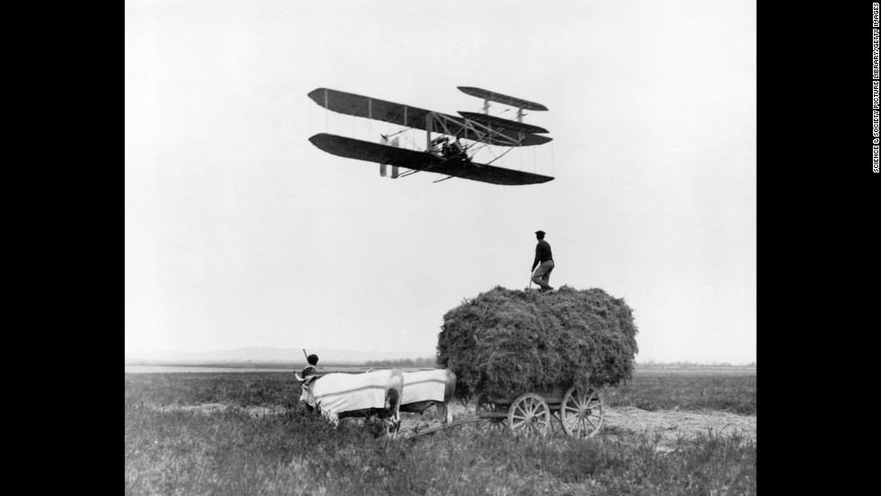 Wilbur Wright flies in Pau, France, in 1908. That year, the Wrights signed a contract with the U.S. Army to provide them with an aircraft that could hold a pilot and passenger while sustaining an hourlong speed of 40 mph.