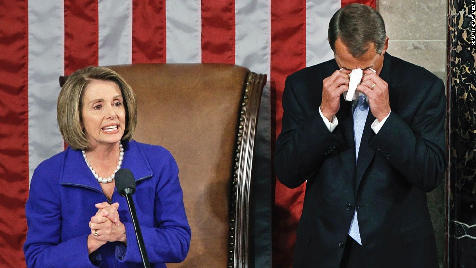 On January 5, 2011, Boehner wipes away tears as he waits to receive the gavel from outgoing House Speaker Nancy Pelosi, D-California, during the first session of the 112th Congress.