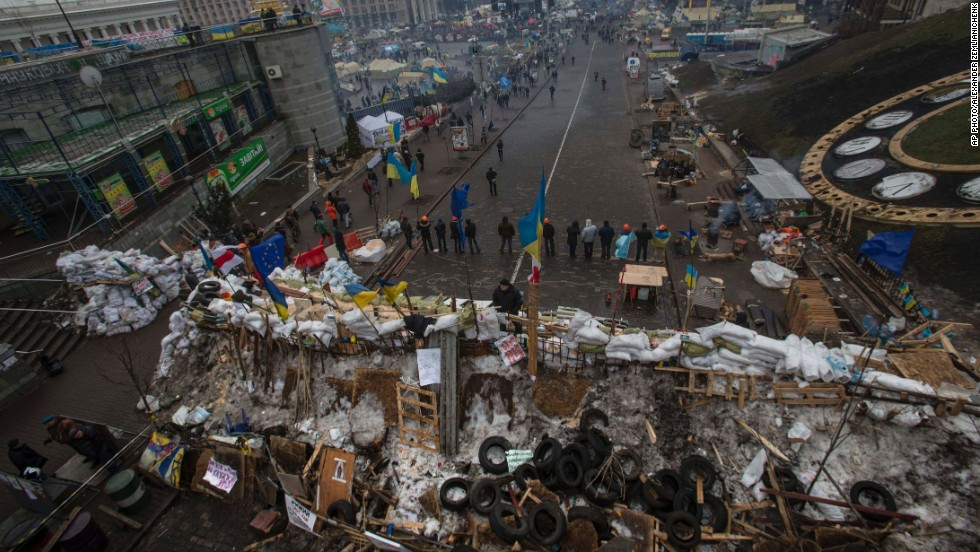 Pro-EU activists stand guard at barricades guarding a heavily fortified tent camp in Independence Square on December 17.