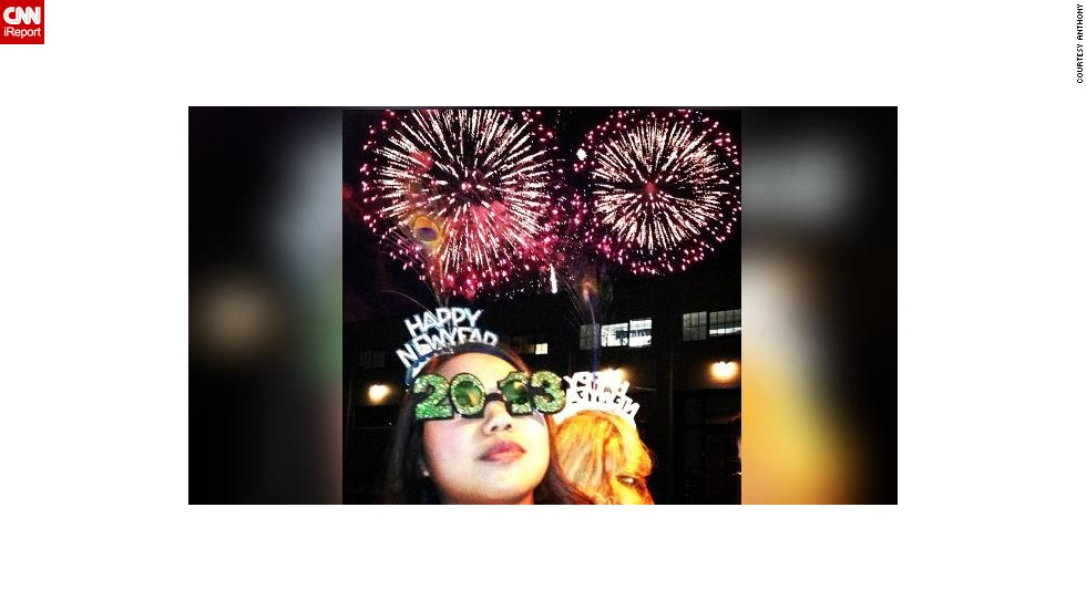 "This photo was taken outside of a waterfront restaurant in San Francisco. ""I am so lucky that my friend Anthony was able to capture not one but TWO fireworks in the background,"" says Callyan, pictured in the glasses."