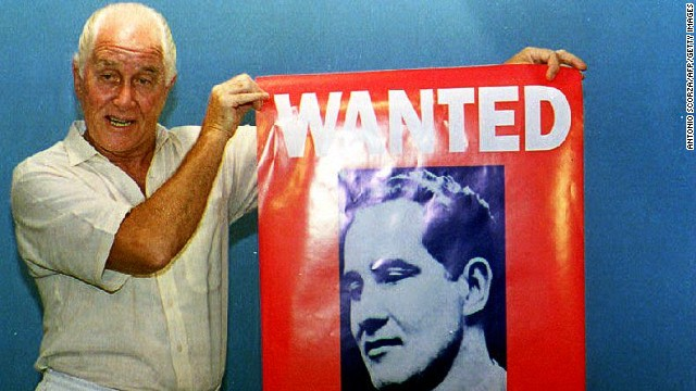 "FILE: Ronnie Biggs holds up a poster of himself during the promotion of his book ""Odd Man Out"" on January 21, 1994 in Rio de Janeiro."