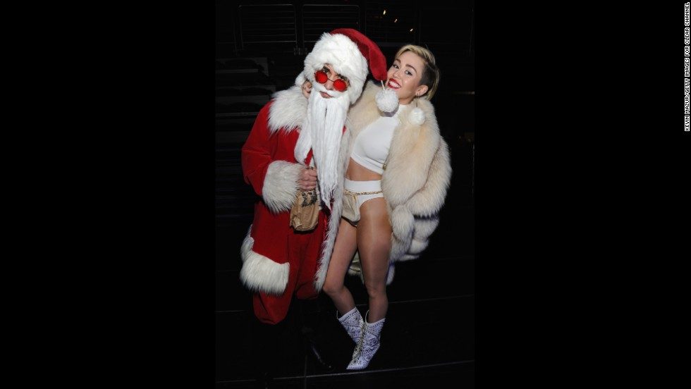 Miley Cyrus poses backstage at Jingle Ball 2013 in Washington on December 16.