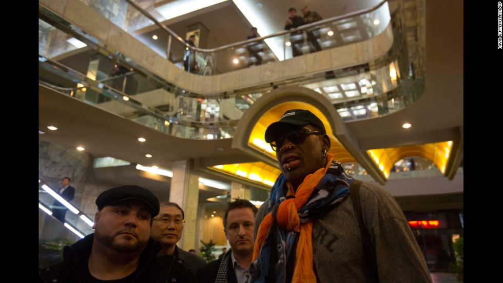 Rodman attracts notice as he enters the Koryo Hotel in Pyongyang on Thursday, December 19.