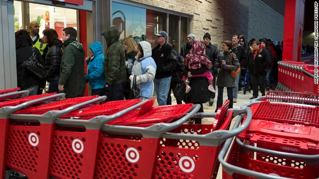 Shoppers enter a Target store in Dartmouth, Nova Scotia, on Friday, Nov. 29, 2013. Black Friday, thought to be the most important shopping day of the year in the United States, is having an impact on Canadian sales as retailers work to keep consumers home, north of the border.
