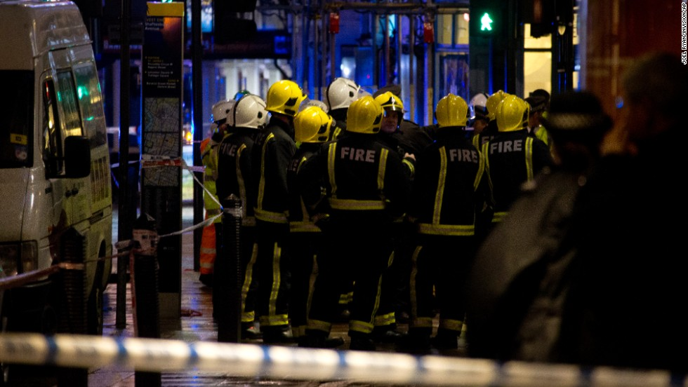 Firefighters confer at the scene. Nick Harding, the London Fire Brigade's Kingsland Station manager, said about 720 people were inside the theater when a section of the ceiling collapsed, taking parts of the balconies with it.