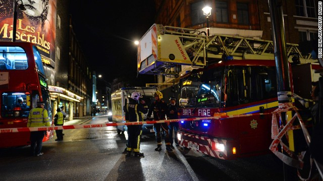 Emergency services personnel assemble behind a cordon following a ceiling collapse at a theatre in Central London on December 19, 2013.   The ceiling of a top London theatre collapsed on the audience during a performance Thursday, causing what police said was an unknown number of casualties and leaving terrified theatregoers covered in blood and dust.  AFP PHOTO/LEON NEALLEON NEAL/AFP/Getty Images