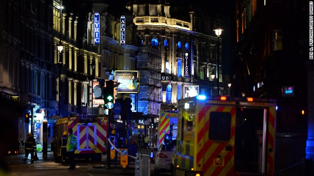 LONDON, ENGLAND - DECEMBER 19:  Members of the emergency services work at the scene of a roof collapse at The Apollo Theatre on December 19, 2013 in London, England. A number of people have been seriously injured after part of the roof of the famous West End theatre collapsed during a packed performance of 'The Curious Incident of the Dog in the Night-Time'.  (Photo by Ben A. Pruchnie/Getty Images)