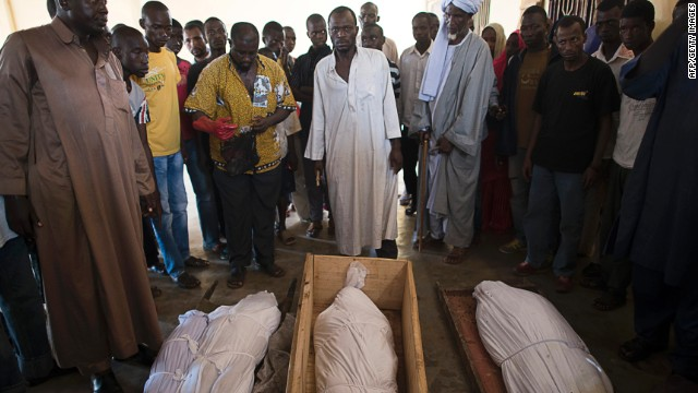 People gather around dead bodies in a mosque of the muslim district of Bangui on December 12, 2013.