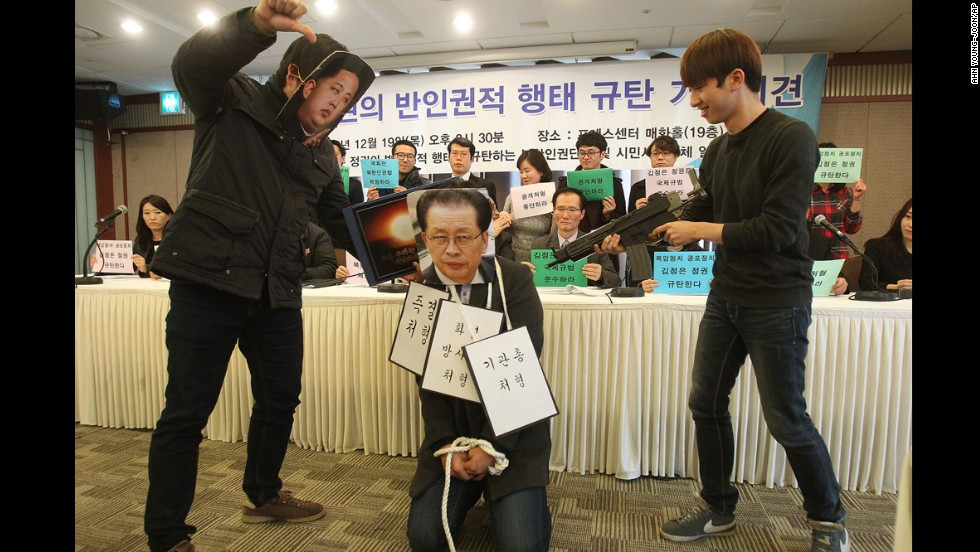 "College students wear masks of Kim, left, and Kim's uncle Jang Song Thaek, center, as they perform during a news conference in Seoul denouncing Kim and alleged human rights violations on Thursday, December 19. <a href=""http://edition.cnn.com/2013/12/13/world/asia/north-korea-uncle-executed/index.html"">Jang's execution</a> earlier this month has unsettled North Korea's neighbors, prompting speculation about instability in the country's leadership."