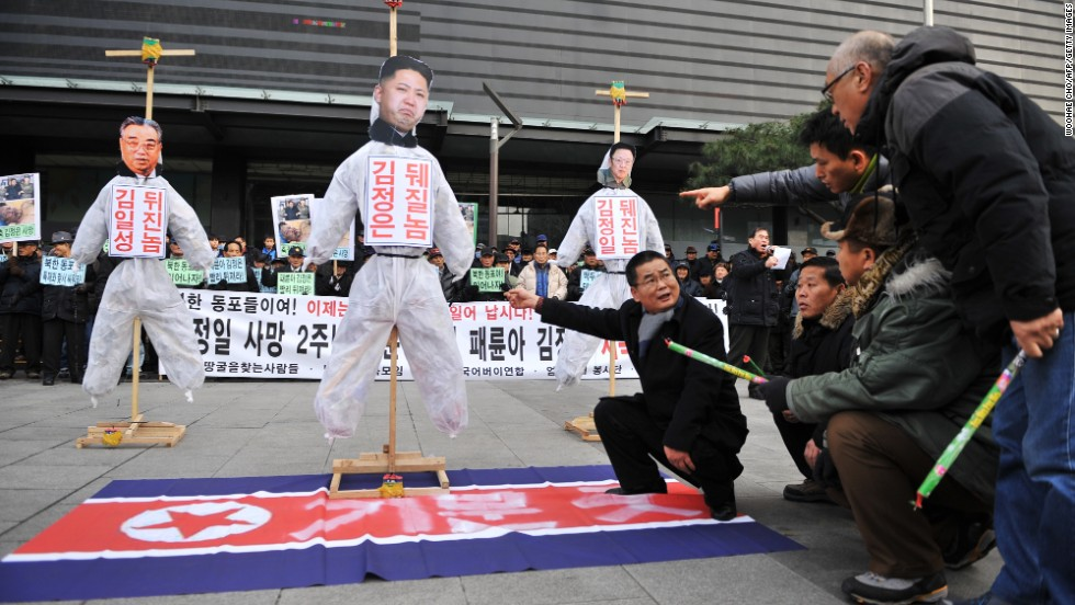 Activists prepare to light effigies of North Korean leaders during a protest in Seoul.