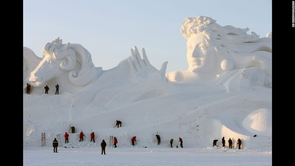 <strong>December 20: </strong>Workers carve a 117-meter-long, 26-meter-high snow sculpture at the Sun Island Park during the 26th China Harbin International Snow Sculpture Art Expo in Harbin, Heilongjiang province, China.