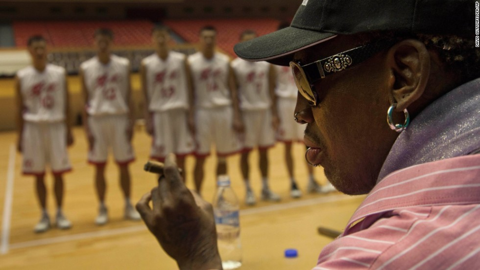 Rodman holds a cigar as he speaks to North Korean basketball players during a practice session in Pyongyang on December 20.
