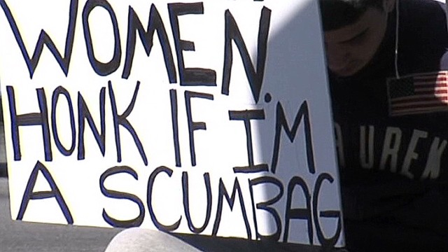 nr accused attacker holds sign_00001314.jpg