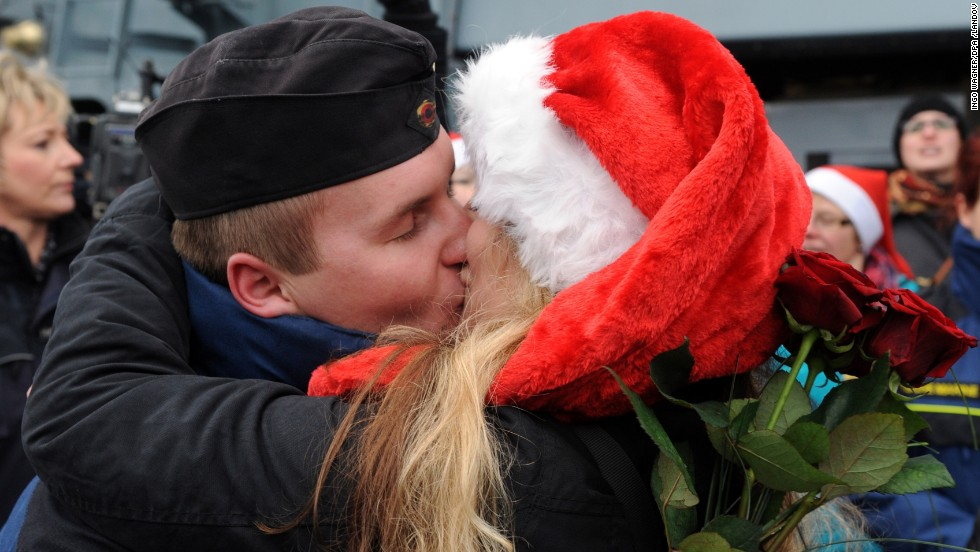 Petty Officer Second Class Sven Gruner is greeted by his girlfriend Rebecca Ankem at the Frigate Niedersachsen, docked after returning to Wilhelmshaven, Germany, on Friday, December 20, from a five-month anti-pirate operation off the Horn of Africa.