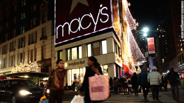 NEW YORK - DECEMBER 22: Shoppers and pedestrians cross 34th Street outside of Macy's Herald Square department store after 10pm December 22, 2009 in New York City. Macy's is staying open 24 hours a day in hopes to boost retail sales numbers in the runup to the Christmas holiday. (Photo by Chris Hondros/Getty Images)