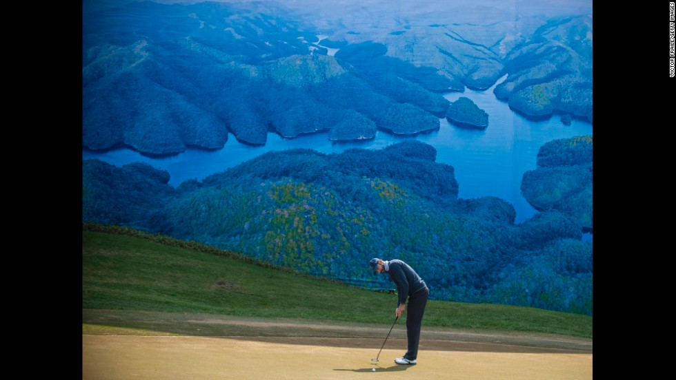 <strong>December 20:</strong>  Alvaro Quiros of Spain putts on at the 6th green during the Royal Trophy Europe vs Asia Championship at the Dragon Lake Golf Club in Guangzhou, China.