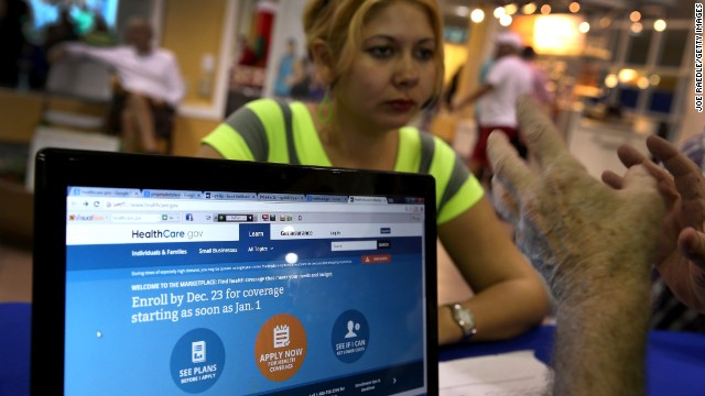MIAMI, FL - DECEMBER 22:  Rocelys Corrales sits with an insurance agent from Sunshine Life and Health Advisors as she inquires about purchasing health insurance under the Affordable Care Act at the kiosk setup at the Mall of Americas on December 22, 2013 in Miami, Florida.  Tomorrow is the deadline for people to sign up if they want their new health benefits to kick in on the 1st of January. People have until March 31, to sign up for coverage that would start later.  (Photo by Joe Raedle/Getty Images)
