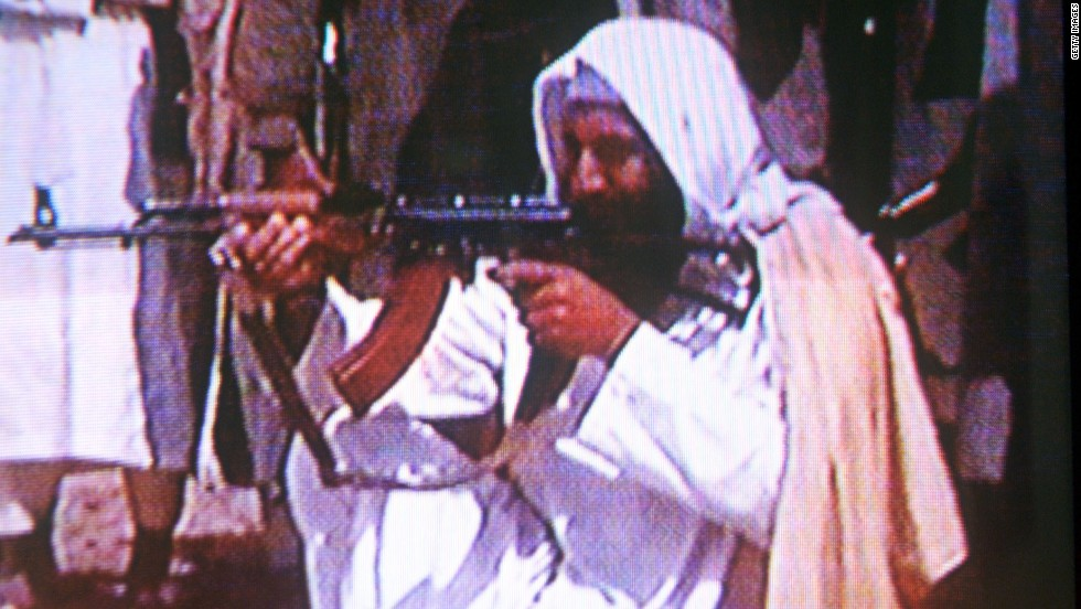 Osama bin Laden fires an AK-47 in this still frame from the infamous video of him released after September 11, 2001.
