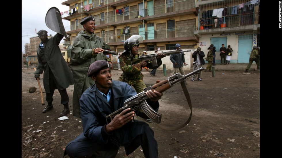 Kenyan policemen confront demonstrators during post-election clashes in the Mathare slums of Nairobi in 2008.