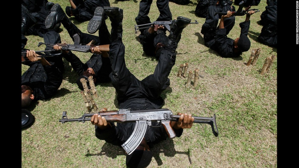 Newly recruited Rangers practice with their AK-47s during a training session at a military camp in the southern Narathiwat province of Thailand in 2009.
