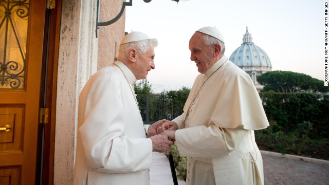 Pope Francis, right, meets with Pope Emeritus Benedict XVI, left, at the Mater Ecclesiae monastery at the Vatican on Monday, December 23.
