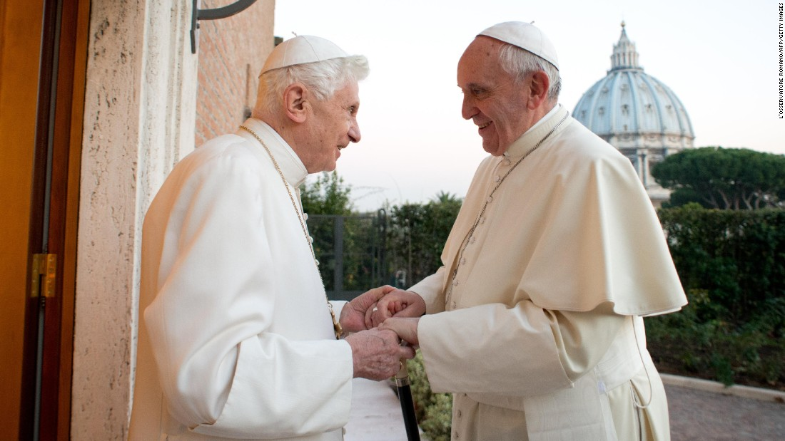 "Pope Francis meets with Pope Emeritus Benedict XVI in the Vatican in December 2013. Benedict surprised the world by resigning ""because of advanced age."" It was the first time a pope has stepped down in nearly 600 years."