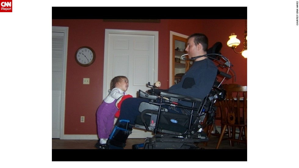 "When Isabel Hayes was a toddler, she'd climb onto her dad's chair for a ride; Ben Hayes has been a quadriplegic since his daughter was 6 months old. ""He used to tilt back and raise her up in the air. She LOVED it,"" Erin Hayes said."