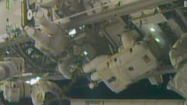 Astronauts complete risky repair job