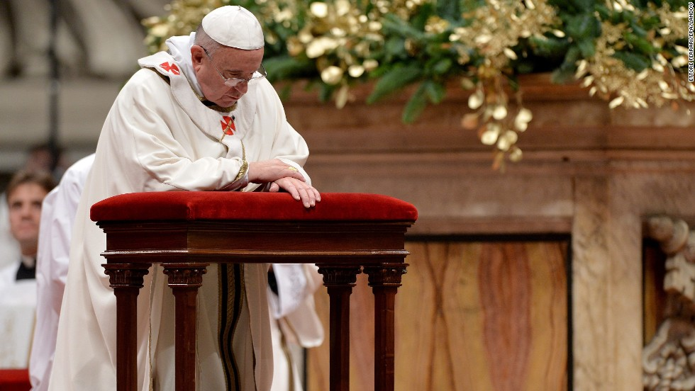 The Pope prays during the service. The festivities began on Saturday, with the Pope's Christmas message to the Curia. He urged the church's governing body to avoid gossip and to focus on service.
