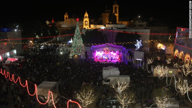 A view of Manger Square and the Church of the Nativity as people gather for Christmas eve celebrations in the biblical West Bank city of Bethlehem, believed to be the birthplace of Jesus Christ, on December 24, 2013. Thousands of Palestinians and tourists were flocking to Bethlehem to mark Christmas. AFP PHOTO/HAZEM BADER (Photo credit should read HAZEM BADER/AFP/Getty Images)