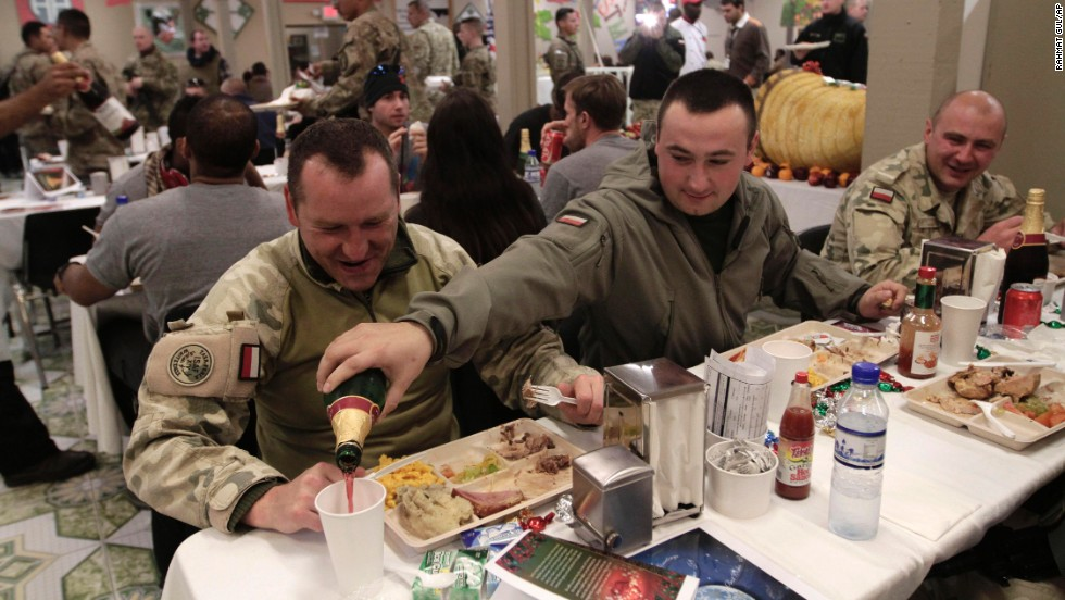 Soldiers from the NATO-led International Security Assistance Force eat Christmas dinner at a base in Afghanistan's Ghazni province.