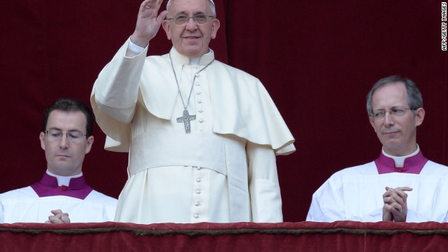 "Pope Francis (C) delivers his traditional Christmas ""Urbi et Orbi"" blessing from the balcony of St. Peter's Basilica on December 26, 2013 at the Vatican."