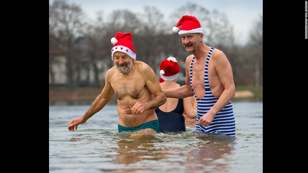 Members of the Berlin Seals group wade into chilly Lake Orankesee in Berlin on Wednesday, December 25. Swimming on Christmas day is a tradition with winter swimmers. Take a look at other lighthearted or interesting moments around the world related to Christmas: