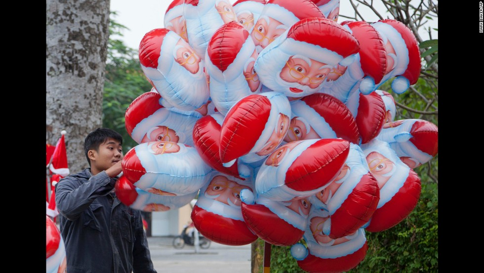 A street vendor sells Santa balloons in Hoi An, Vietnam.