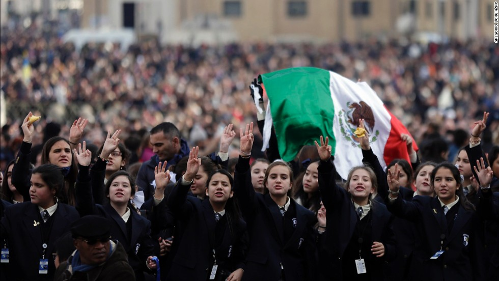 Faithful cheer before the Pope's message. Vatican TV estimated 150,000 attended the blessing in St. Peter's Square, which marked Francis' first Christmas celebration as pope.