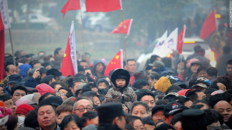 People wait to eat free noodle in Mao Zedong's anniversary of 120 birthday at his hometown in Shaoshan, China.