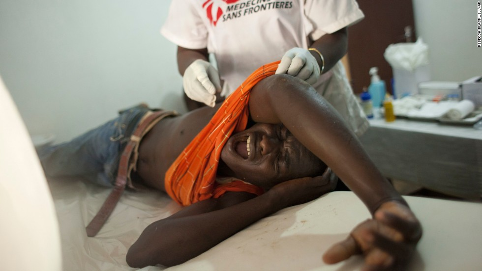 A young man who was hit in the back by a stray bullet cries out in pain at a Doctors Without Borders clinic in Bangui on Wednesday, December 25.