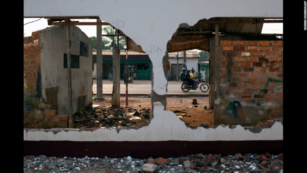 A motorcycle passes the remains of a mosque that was destroyed in Bangui in December.