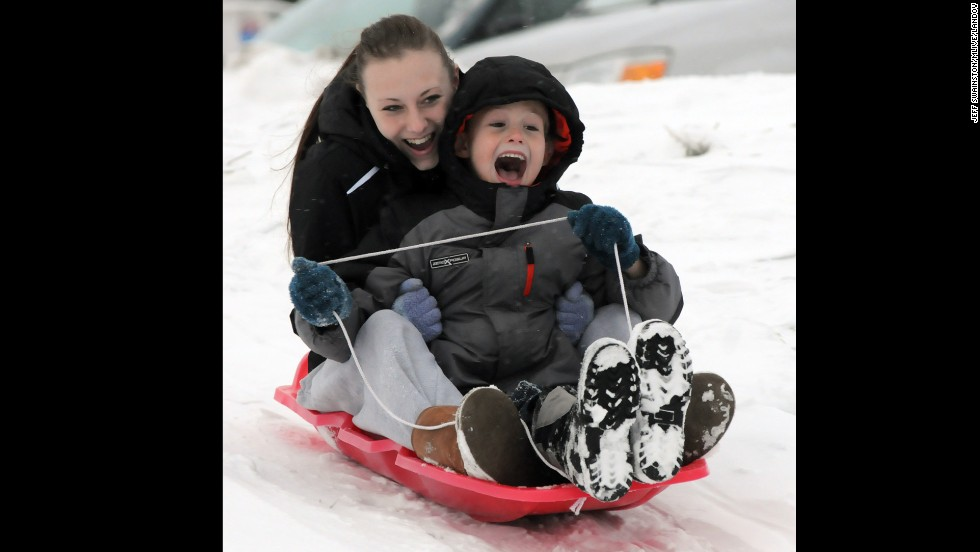 Shannon Abbott of Byron Center, Michigan, and her cousin, P.J. Swainston, slide on the slopes near Dorr, Michigan, on Wednesday, December 25.