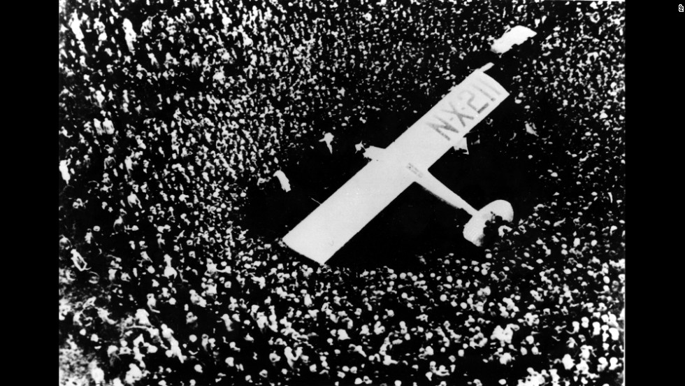 The Spirit of St. Louis is surrounded by spectators after its pilot, Charles Lindbergh, completed his historic trans-Atlantic flight in May 1927. Lindbergh flew nonstop from Long Island, New York, to Paris.