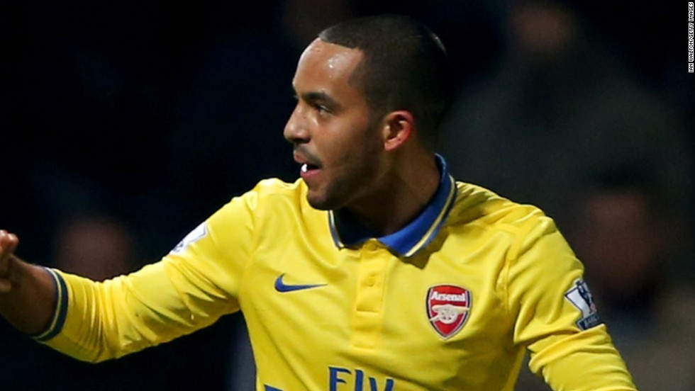A double from Theo Walcott and a third from the returning Lukas Podolski helped Arsenal to a 3-1 win at struggling West Ham to go back to the top of the EPL.