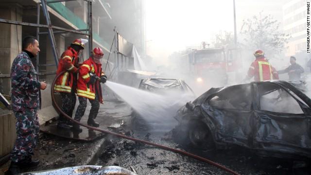 Firemen douse a burning car following a huge blast that rocked central Beirut on December 27, 2013, killing an adviser to former anti-Syria coalition prime ministers Saad Hariri and Fuad Siniora and sending plumes of black smoke scudding across the skyline of the Lebanese capital. Mohammad Chatah (Shatah), a prominent economist who was also an ex-minister of finance and Lebanon's envoy to Washington was assassinated when a car bomb targeted his convoy in the city centre, the Lebanese state news agency said. AFP PHOTO / STR        (Photo credit should read STR/AFP/Getty Images)