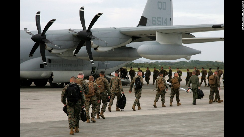 Japan-based Marines board an aircraft for areas hit by Typhoon Haiyan hit in the Philippines at Marine Corps Air Station Futenma on November 10.
