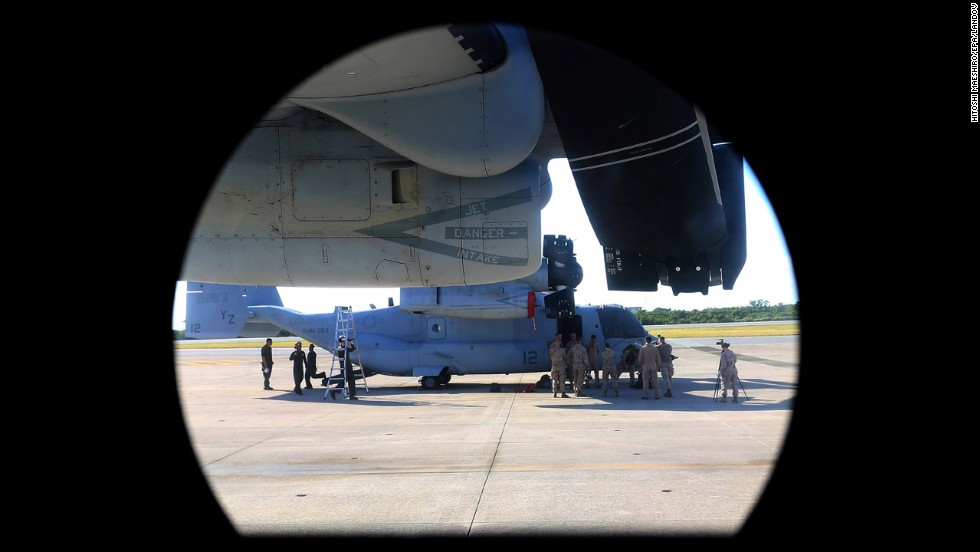 A U.S. Marine Corps' MV-22 Osprey tilt-rotor aircraft is seen through the window of another Osprey at Futenma on August 3.