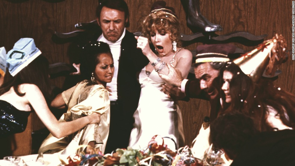 """<strong>""""The Poseidon Adventure""""</strong> -- The cruise ship Poseidon is hit by a tidal wave on New Year's Eve. A group of survivors (including Gene Hackman, Ernest Borgnine and Shelley Winters) has to get to the bottom of the boat to get to the top of the water -- through explosions, fire and flooded compartments. And you thought your NYE party was a disaster."""