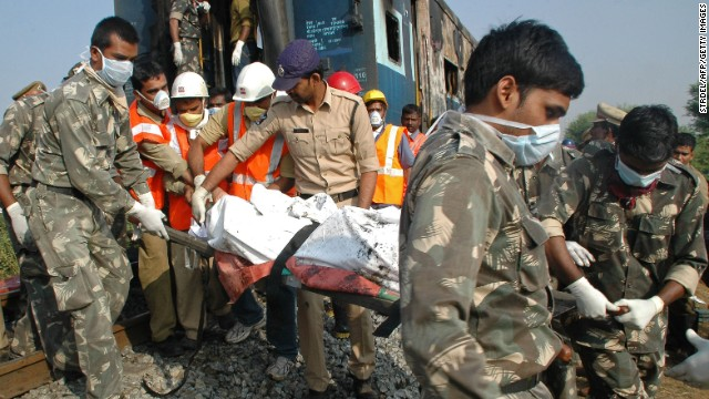 Indian rescuers carry away a victim of  the deadly train fire.